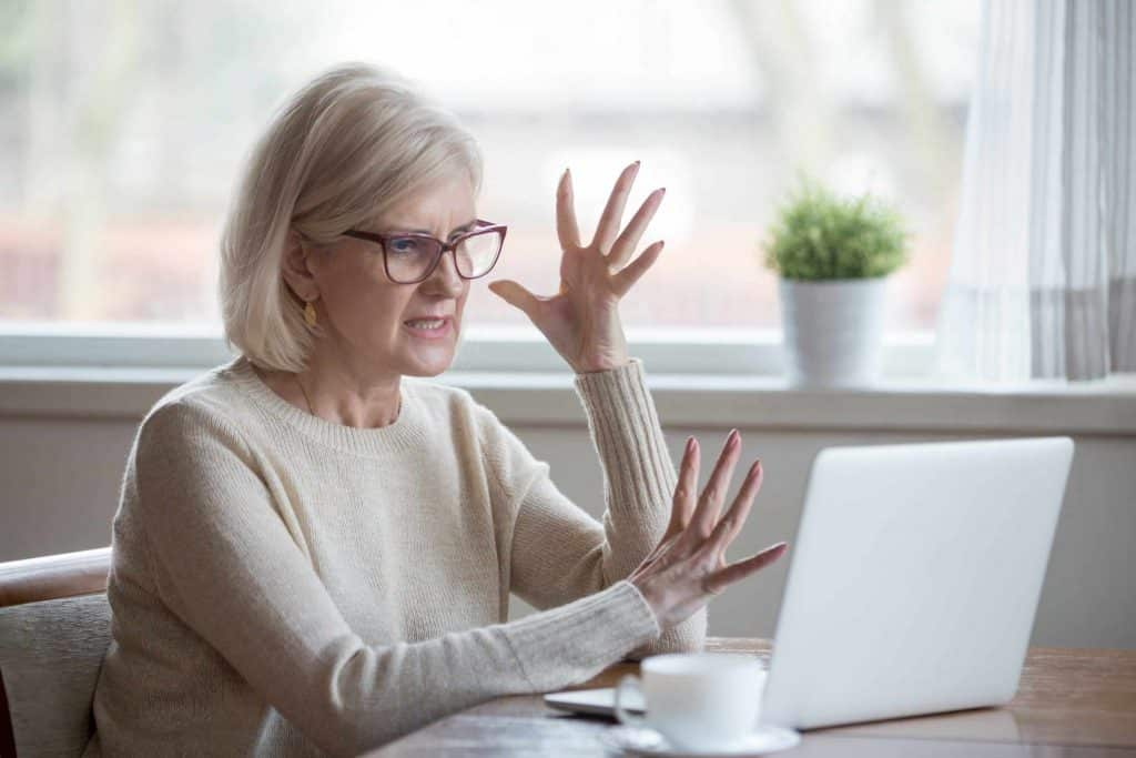 Elderly woman frustrated with timeshare maintenance fees